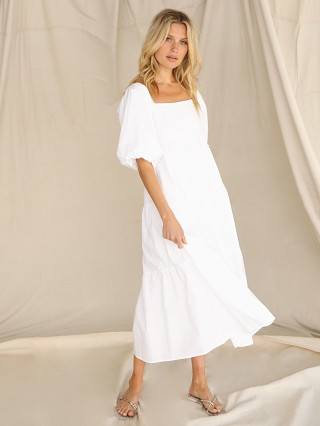 Model in plain white Faithfull the Brand Kiona Midi Dress