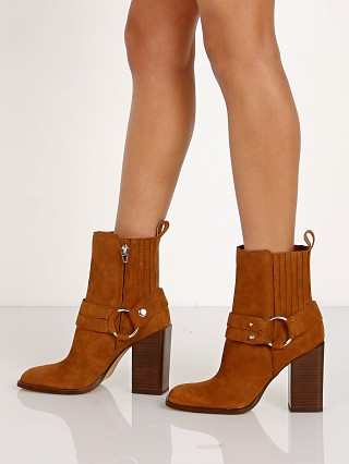 Model in brown Dolce Vita Isara Suede Boot