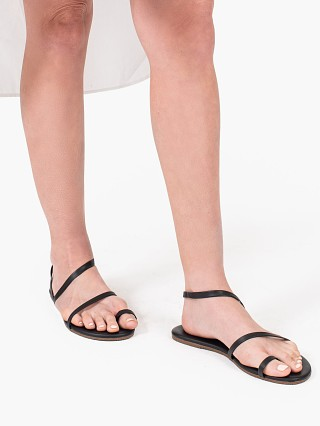 Model in sable Tkees Mia Nappa Sandal