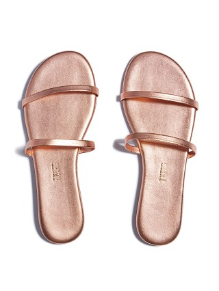 Model in beach pearl Tkees Gemma Sandal