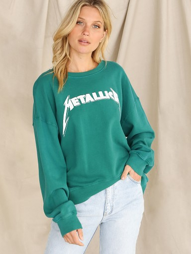 Model in hunter green Daydreamer Metallic Birth School Sweatshirt