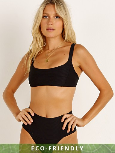 Model in black L Space Eco Jess Bikini Top
