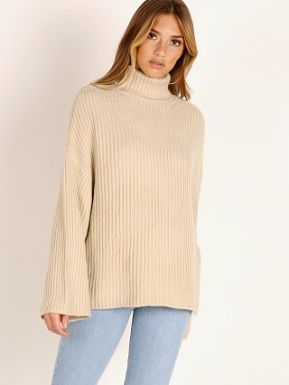 Model in bisque Indah Denali Oversize Turtleneck
