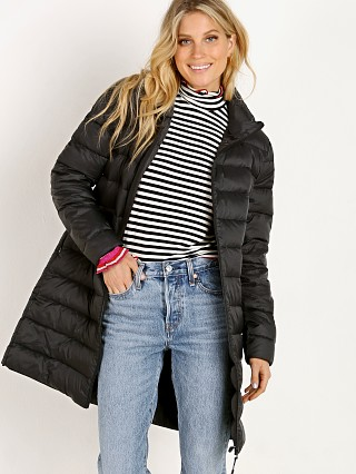 Model in black BB Dakota Puff Love Puffer Jacket