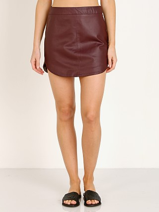 Model in boysenberry BB Dakota Conrad Leather Mini Skirt