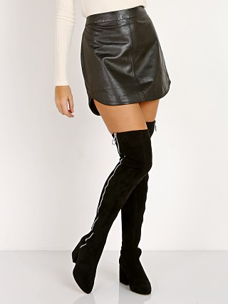 Model in black BB Dakota Conrad Leather Mini Skirt