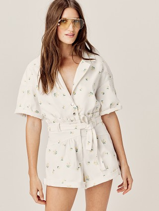 Model in daisy For Love & Lemons Waverly Romper