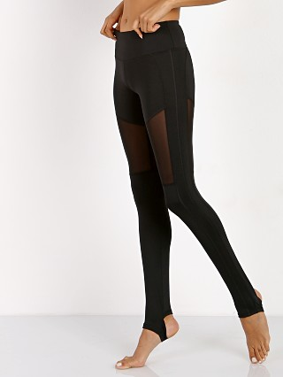Model in black Varley Hillcrest Flow Stirrup Legging