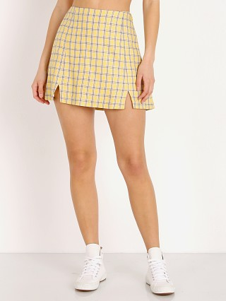 Model in yellow plaid Capulet Rosa Mini Skirt