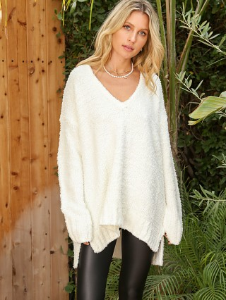 Model in white Show Me Your Mumu Hug Me Sweater