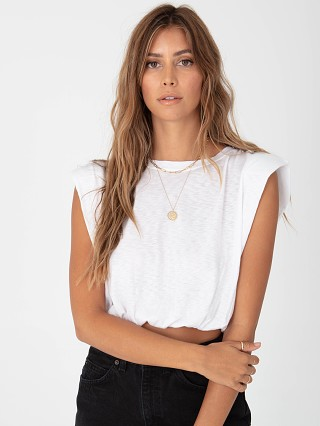 Model in white Stillwater Strong Shoulder Crop Tank