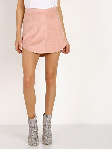 Model in pink lemonade BB Dakota Annette Faux Suede Skirt