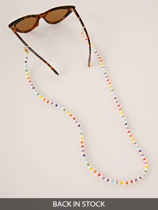 Model in rainbow + pearl Golden Days LA Pearl w/Rainbow Mask Catcher/Sunglasses Chain