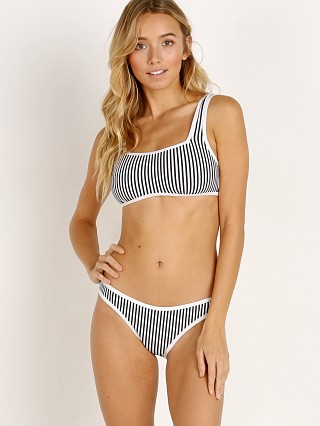 Model in black and white Zulu & Zephyr Rift Bralette Bikini Set