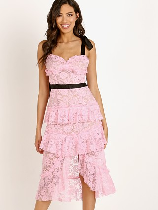 Model in pink For Love & Lemons Iris Hi Lo Dress