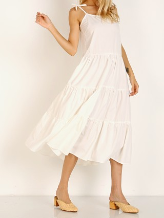 Model in cream Solid & Striped Tiered Poplin Dress
