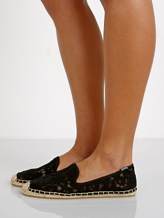 Model in black Soludos Smoking Slipper Tulip Lace