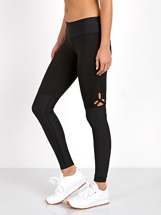 Model in black Track & Bliss Star Cut-Out Legging