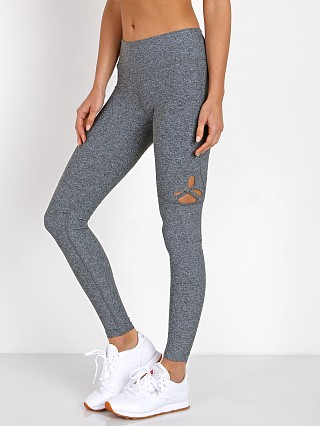 Model in grey Track & Bliss Star Cut-Out Legging