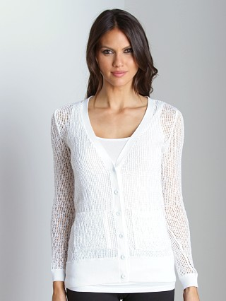 Model in white Free People Knit Cardi