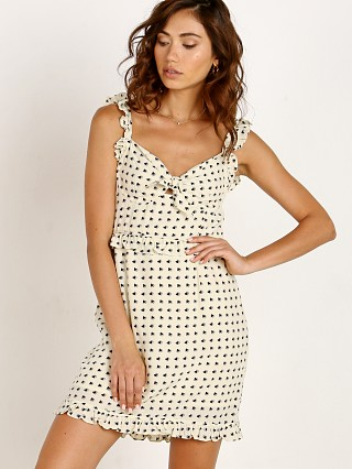 Model in creme For Love & Lemons Sweetheart Mini Dress