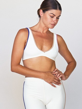 Model in ivory Acacia Komala Sports Bra