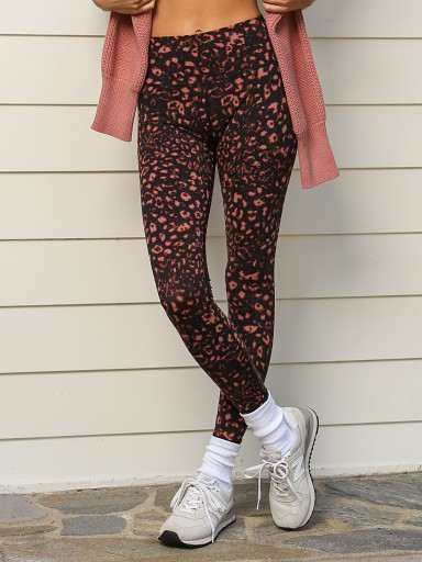 Model in red animal Varley Luna Legging
