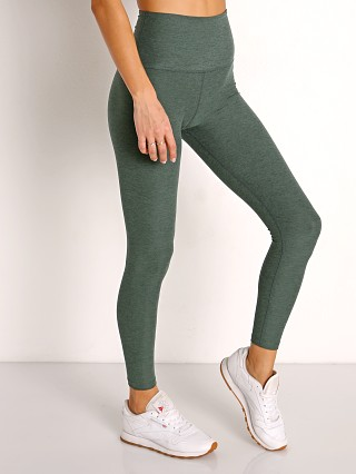 Model in green ivy Beyond Yoga Spacedye Midi High Waisted Legging