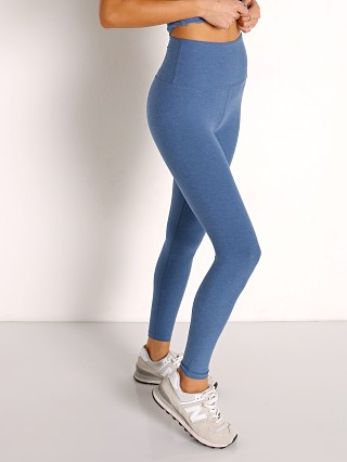 Model in washed denim Beyond Yoga Spacedye Midi High Waisted Legging