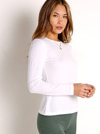Model in white Beyond Yoga Go to Crew Pullover