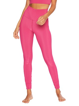 Model in fuchsia rib Beach Riot Ayla Legging Fuchsia