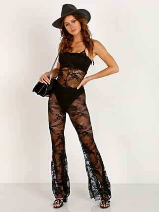 Model in black Indah Clearwater Lace Jumpsuit