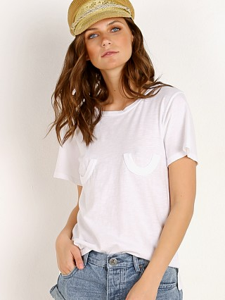 Model in white LNA Clothing Sienes Tee