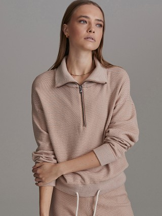 Model in praline/ivory Varley Buckingham Sweater