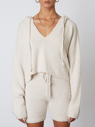 Model in natural NIA Notched Hooded Sweater