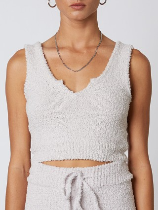 Model in dove NIA Notched Sweater Tank