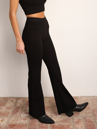 Model in black Indah Body Penne Solid Bootcut Pant