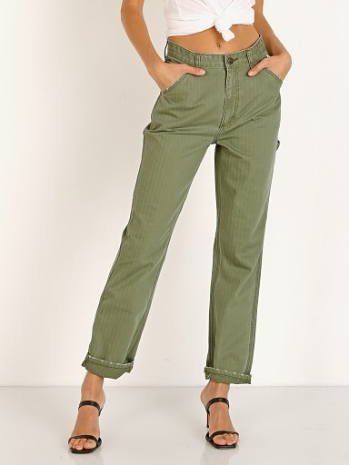 Model in olive herringbone Lee Vintage High Rise Dungaree Ankle