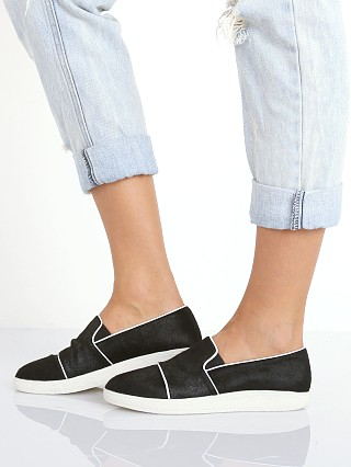 Model in pony black SOL SANA Tab Slip On Pony