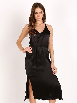Model in plain black Faithfull the Brand East West Dress