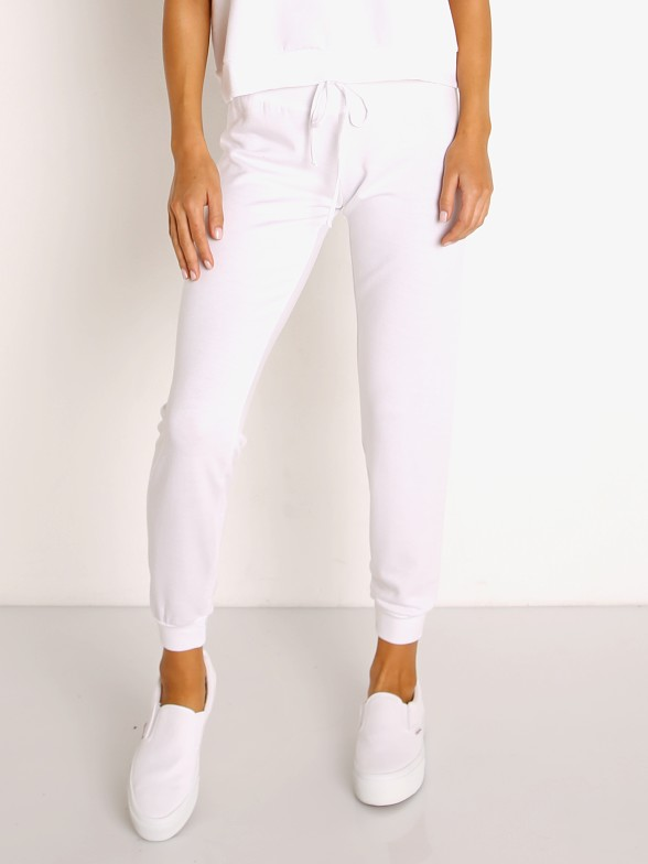 Model in white Beyond Yoga Cozy Fleece Lounge Around Jogger