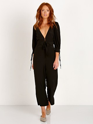 Model in noir For Love & Lemons Georgi Jumpsuit