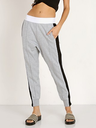 Model in grey PE NATION The Master Run Pant