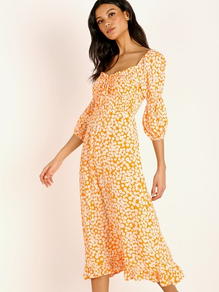 You may also like: Faithfull the Brand Nora Midi Dress Dusty Floral Print