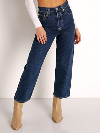 Model in across a plain Levi's 501 Jeans