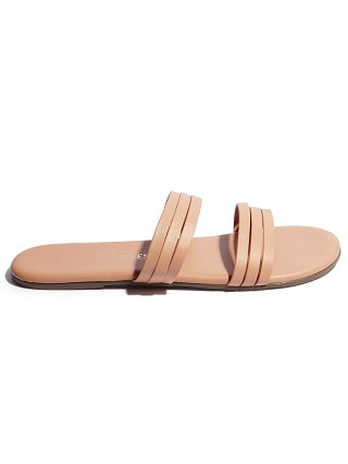 Model in pout Tkees Allegra Sandal