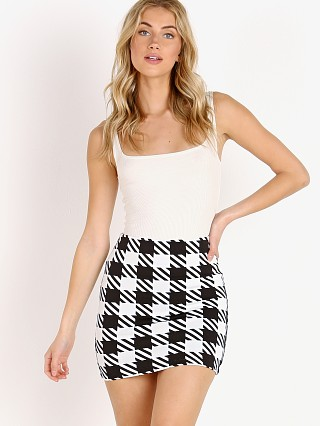 Model in black gingham Solid & Striped The Delilah Skirt