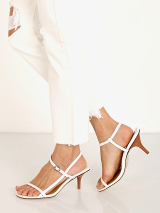 Model in ivory Jaggar Strappy Patent Leather Sandal
