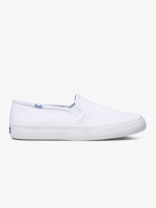 Model in white Keds Double Decker