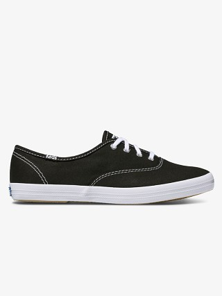 Model in black Keds Champion Originals Sneaker